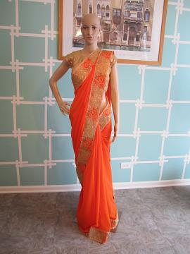 Festive orange gold party wear saree